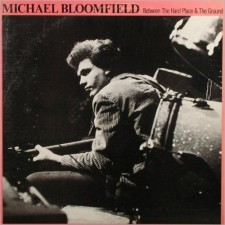 bloomfield-between_a_hard_place_&_the_ground-front